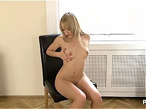 sexy platinum-blonde massaging her clit