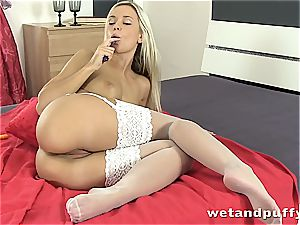 babe in milky stocking touches herself with faux-cock