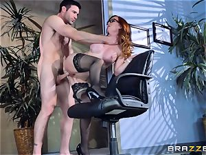Dani Jensen playing with man sausage in the office