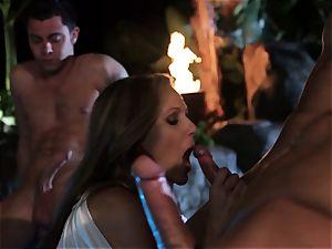 Julia Ann inhales a group of cocks in a pool