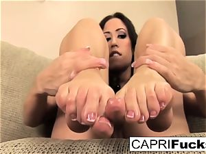 Capri plays with her vulva and feet
