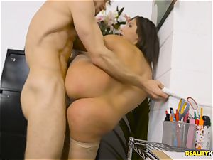 Abella Danger is bored at work and hungers man-meat