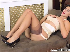 busty brunette strokes off in vintage nylons garter high-heeled shoes