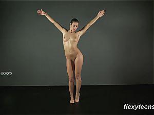 cute gymnast doll spreads her vag seductively