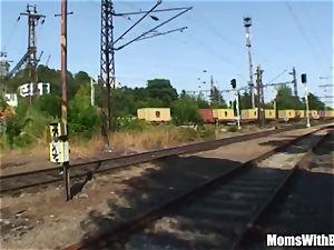 elderly dark-haired chick plumb Along The train Tracks