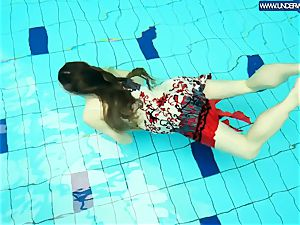 sizzling grind redhead swimming in the pool