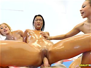 Adrian Maya, Cristi Ann and Amy Parks get down and oily
